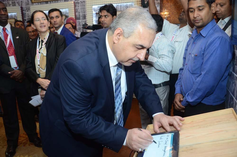 Mr. Safaa Ibraheem Jasim (Commissar, Independent High Electoral Commission of Iraq) writing on the Graffiti wall